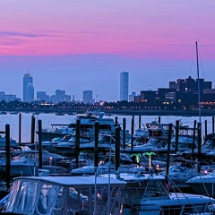 Marina at sunset with view of Boston skyline