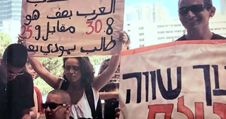 Article regarding book cover image of Israeli youth holding protest signs