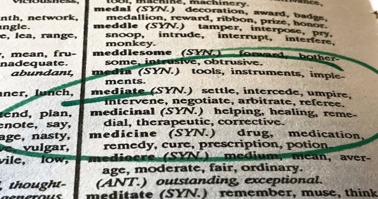 Article regarding dictionary page showing the meaning of the word mediate
