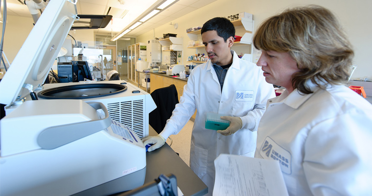 Article regarding Diego Almanza and Amy Avery work with the equipment in UMass Boston's Genomics Core
