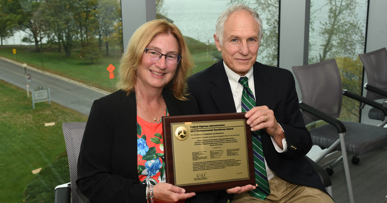 Article regarding Ellen Douglas and Paul Kirshen and the Federal Highway Administration's 2017 Environmental Excellence Award