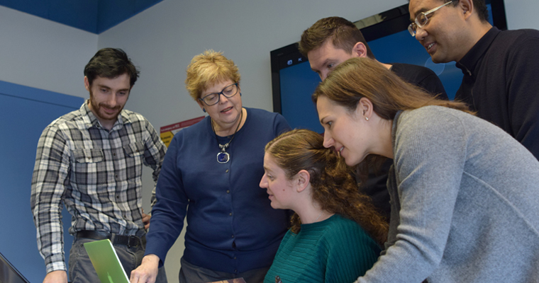 Article regarding Associate Professor of Public Policy and Public Affairs Christine Thurlow Brenner meets with UMass Boston graduate students.