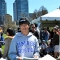 UMass Boston student Keishiro Ota speaks to attendees of the Japan Festival in the Boston Common.