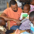 Gasana reading to children at the Kigali Reading Center in Rwanda.
