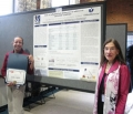 Dr. Hardy (left) in front of her award winning poster with Dr. Hayman