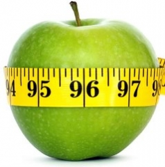 apple with a tape measure around it