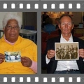 Picture of two people holding up photos they contributed to the Mass. Memories Road Show
