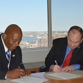 Chancellor J. Keith Motley and AIM President Richard C. Lord signed a scholarship memorandum.