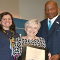 "Patricia ""Pat"" O'Neill receives the Quinn Award from Chancellor Motley and Elaina Quinn, Bob Quinn's daughter"