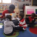 Chris Wade reads with students at Holland Elementary School in Dorchester.