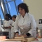 Barbara Lynch creates her gnocchi dish for a UMass Boston audience.