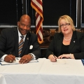 UMass Boston Chancellor J. Keith Motley and Vice Chancellor and Chief Executive of Plymouth University Wendy Purcell signing the MOU.