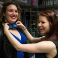 Junior Cassidy Bane tries a bowtie on junior Colleen Fitzgibbons.