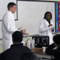 UMass Boston chemistry students acting out Fusion Science Theater plays for Dever-McCormack eighth graders