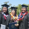 Graduates from the Pacific Islands show off their new diplomas.