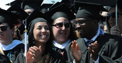 Happy graduates at UMass Boston commencement on May 31.