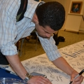 The Boston Marathon Remembrance ceremony included an opportunity to sign a healing banner.