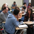 Students using iPads in a UMass Boston classroom