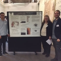 Graduate student Edward Saenz, research fellow Zhan Li, Professor Crystal Schaaf, and graduate student Peter Boucher in front of a poster