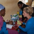 Alia MacPherson consults with a patient on a recent Kenya Heart and Sole trip