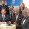 Mayor Martin J. Walsh, Chancellor J. Keith Motley, and Provost Winston Langley sign a memorandum of understanding.