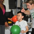 Exercise and Health Sciences students interact with the children in the All Abilities Active program at the Oak Square YMCA.