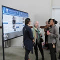 Faculty and staff members discuss their projects at the Community-Engaged Partnerships Symposium's poster session.