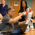 Teachers and IT professionals learned how to program robots during BATEC's summer institute.