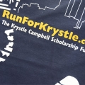 Students purchase Run for Krystle T-shirts in the Campus Center.