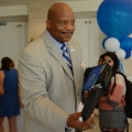 Chancellor J. Keith Motley hands a lunch bag to a student in the Campus Center.