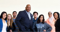 UMass Boston students surrounding Chancellor J. Keith Motley