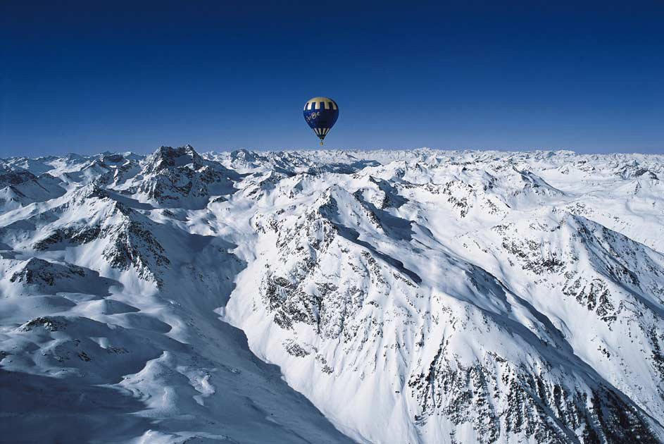 Hot air balloon over a mountain