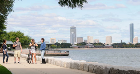 UMass students walking along the Boston Harbor.