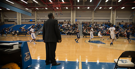Charlie Titus watches the action on the court