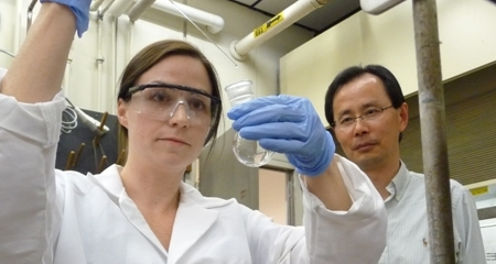 Associate Professor of Green Chemistry Wei Zhang and student researcher in the green chemistry lab.