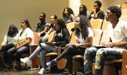 Students watch a performance