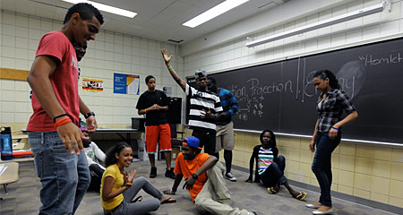 Students in the Urban Scholars Program act out a scene from Hamlet.