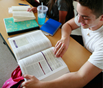 Picture of student looking at a book