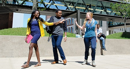 Students wave goodbye to each other on campus at UMass Boston