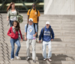 Five UMass Boston students descending the Campus Center stairs