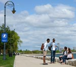 Four UMass Boston students take a break on the HarborWalk