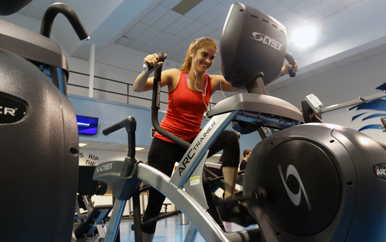 Student working out in Beacon Fitness Center