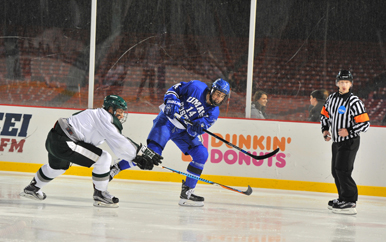 Men's hockey players playing in Frozen Fenway at Fenway Park