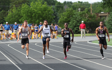 Competitors in the men's 100-meters track and field event