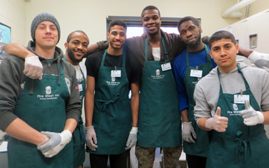 Members of UMass Boston's men's basketball team volunteer at the Pine Street Inn