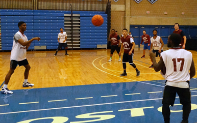 UMass Boston students playing intramural basketball in the Clark Athletic Center