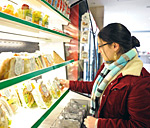 Student looking at packaged food