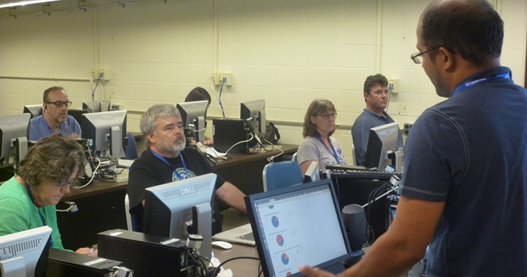 Teachers work on their computer science skills at BATEC's  Exploring Computer Science course.