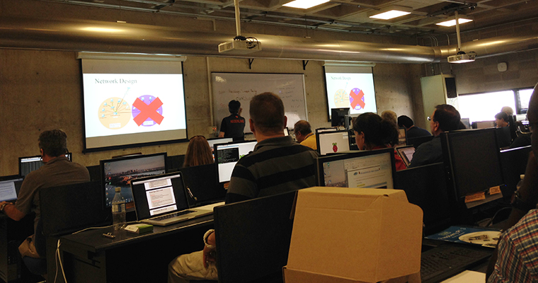 Instructor conducts network engineering class for teachers.
