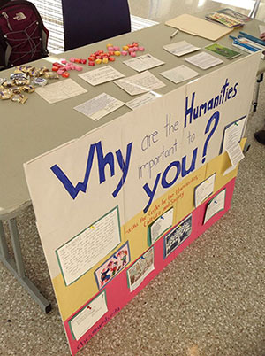 table with banner reading 'why study the humanities?'